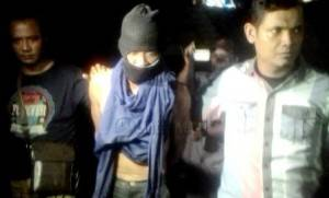 Tersangka Miswardi saat Digiring Polisi Ke Ruangan Satreskrim Polres Tanjungpinang.